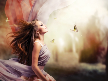 Photo for Beautiful Girl in Fantasy Mystical and Magical Spring Garden  - Royalty Free Image