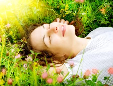 Foto de Beautiful Young Woman Outdoors  Enjoy Nature  Meadow  - Imagen libre de derechos