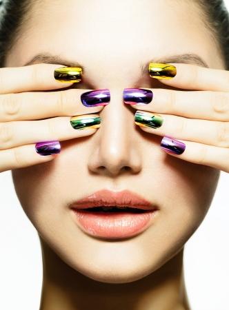 Foto de Manicure and Make-up  Nail art  Beauty Woman With Colorful Nails  - Imagen libre de derechos
