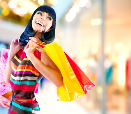 Photo pour Beauty Woman with Shopping Bags in Shopping Mall  - image libre de droit