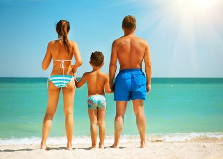 Foto de Happy Family Having Fun at the Beach  Summer Holidays - Imagen libre de derechos
