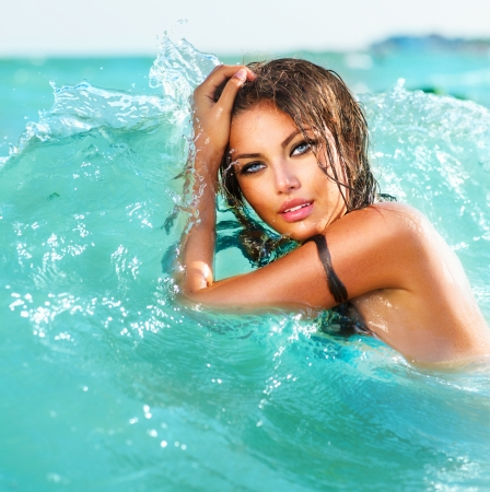 Beauty Sexy Model Girl Swimming and Posing in the Water