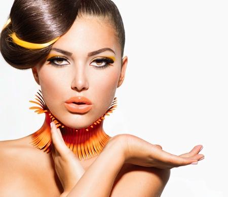 Foto de Fashion Model Girl Portrait with Yellow and Orange Makeup  - Imagen libre de derechos