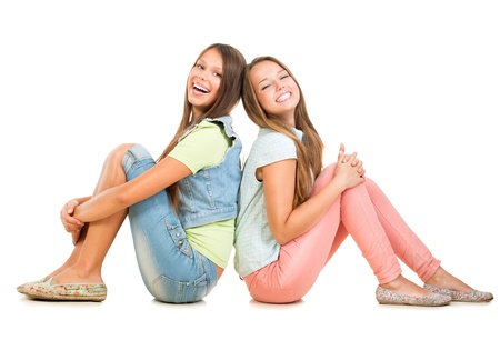 Photo for Two Smiling Teenage Girls Isolated on White Background  Friends  - Royalty Free Image