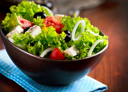 Photo pour Mediterranean Salad with Feta Cheese, Tomatoes and Olives  - image libre de droit