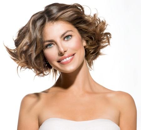 Photo pour Beauty Young Woman Portrait over White  Short Curly Hair  - image libre de droit