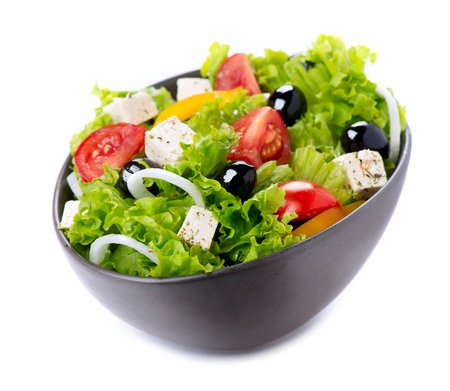 Foto de Greek Salad with Feta Cheese, Tomatoes and Olives - Imagen libre de derechos