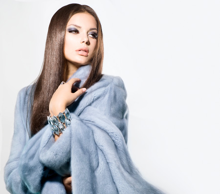 Photo for Beauty Fashion Model Girl in Blue Mink Fur Coat  - Royalty Free Image