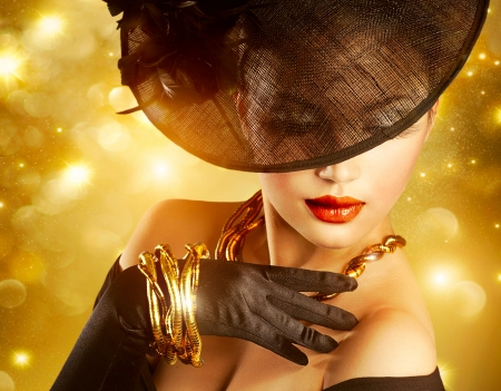 Foto de Luxurious Woman over Holiday Golden Background - Imagen libre de derechos