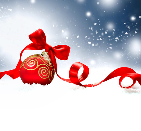 Foto de Christmas Holiday Background with Red Bauble, Ribbon, Snow and Snowflakes - Imagen libre de derechos