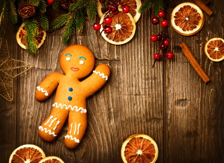 Gingerbread Man over Wood Christmas Holiday Background