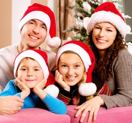 Foto de Christmas Big Family with Kids near The Christmas Tree - Imagen libre de derechos