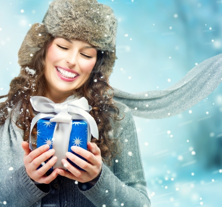 Photo for Beautiful Young Woman with Christmas Gift Box  Surprised Girl  - Royalty Free Image