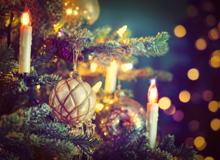 Photo pour Christmas Tree Decorated with Baubles, Garlands and Candles - image libre de droit