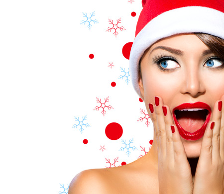 Foto de Christmas Woman  Beauty Model Girl in Santa Hat - Imagen libre de derechos