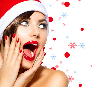 Photo for Christmas Woman  Beauty Model Girl in Santa Hat over White - Royalty Free Image