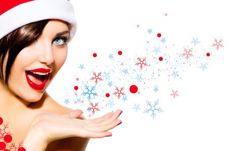 Foto de Christmas Woman  Beauty Girl in Santa Hat isolated on White - Imagen libre de derechos
