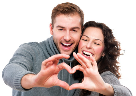 Photo pour Valentine Couple  Girl and her Boyfriend making shape of Heart  - image libre de droit