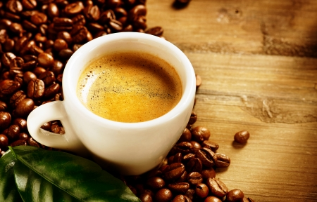 Photo pour Coffee Espresso  Cup Of Coffee with Beans and Green Leaf - image libre de droit
