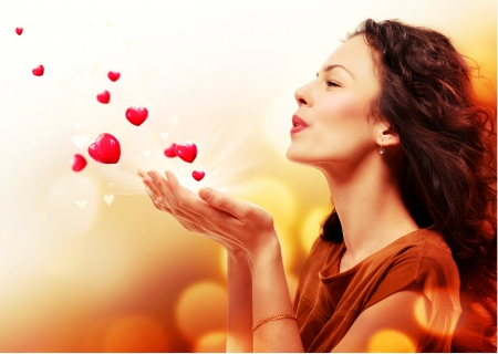 Woman Blowing Hearts from her Hands  St  Valentines Day Concept