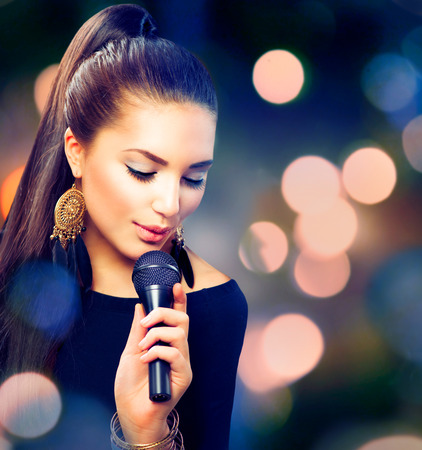 Photo for Beautiful Singing Girl  Beauty Woman with Microphone - Royalty Free Image