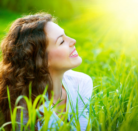Photo for Beautiful Spring Young Woman Outdoors Enjoying Nature - Royalty Free Image