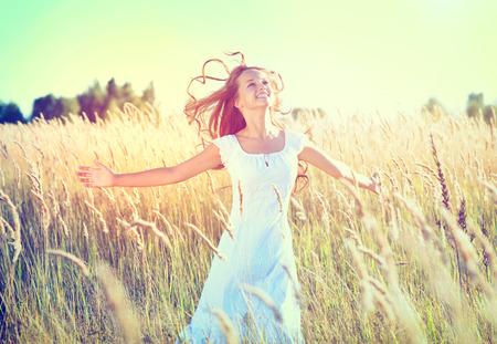 Beauty Girl Outdoors enjoying nature  Beautiful Teenage Model