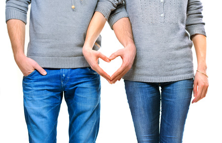 Photo for Valentine couple in love showing heart with their fingers - Royalty Free Image