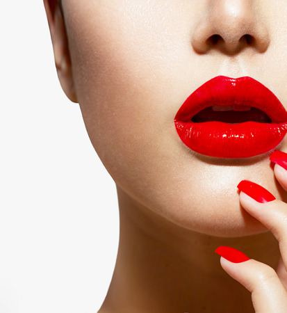 Photo pour Red Sexy Lips and Nails closeup  Manicure and Makeup - image libre de droit