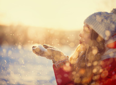 Photo for Beauty Winter Girl Blowing Snow in frosty winter Park  Outdoors  - Royalty Free Image