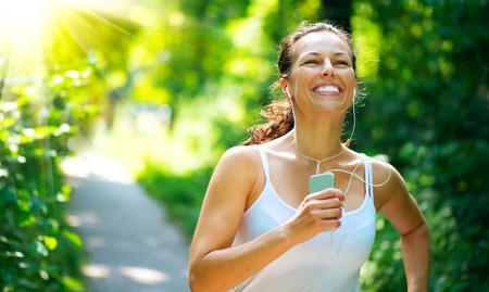 Photo pour Running Woman  Outdoor Workout in a Park - image libre de droit