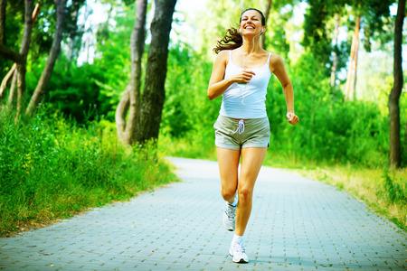 Photo pour Running Woman  Outdoor Workout in a Park  Full Length Portrait - image libre de droit