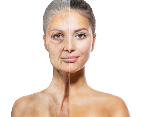 Foto de Aging and Skincare Concept  Faces of Young and Old Women - Imagen libre de derechos