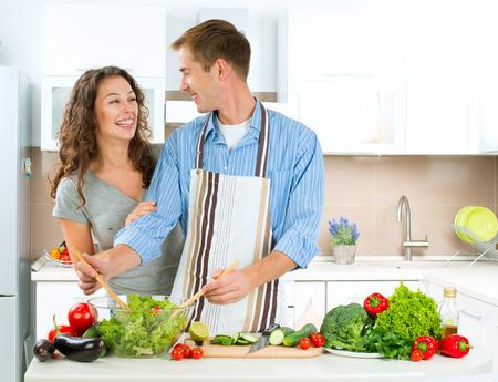 Photo pour Happy Couple Cooking Together  Dieting  Healthy Food - image libre de droit