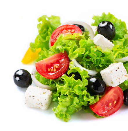 Foto de Mediterranean Salad  Greek Salad isolated on a White Background - Imagen libre de derechos