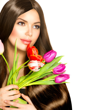 Foto de Beauty Woman with Spring Bouquet of Tulip Flowers - Imagen libre de derechos