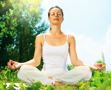 Photo for Young Woman doing Yoga Exercises Outdoor  - Royalty Free Image