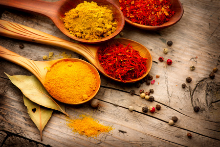 Photo for Various spices and herbs over wooden background - Royalty Free Image