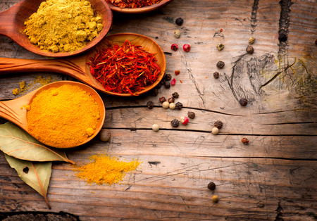 Photo for Spices and herbs  Curry, saffron, turmeric, cinnamon over wood - Royalty Free Image