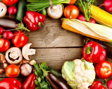 Healthy Organic Vegetables on a Wooden Background
