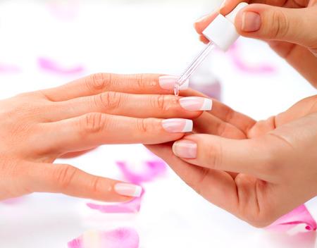 Photo pour Cuticle oil  Manicure and Hands Spa  Woman Hands Closeup - image libre de droit