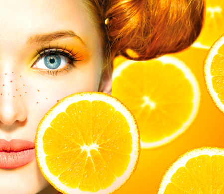 Photo for Beauty model girl with juicy oranges  Freckles  - Royalty Free Image
