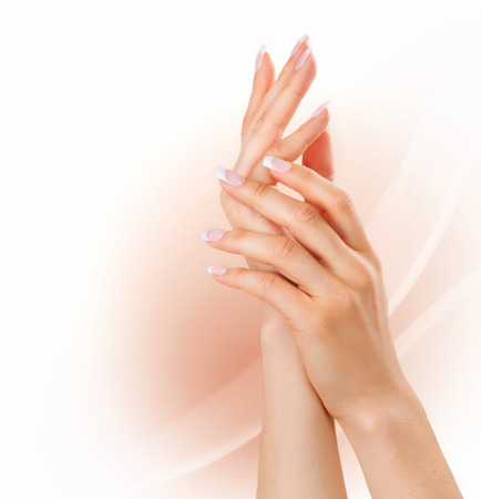 Photo pour Manicure concept  Woman hands with french manicure - image libre de droit