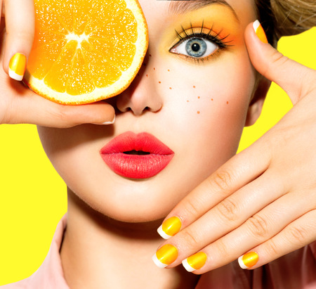 Photo pour Teen girl with freckles, red hairstyle, yellow makeup and nails - image libre de droit