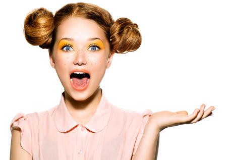 Foto de Beautiful joyful teen girl with freckles and yellow makeup - Imagen libre de derechos