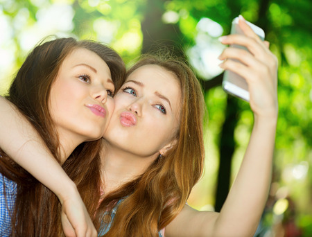 Photo for Teen friends taking photos with a smartphone  Selfie - Royalty Free Image
