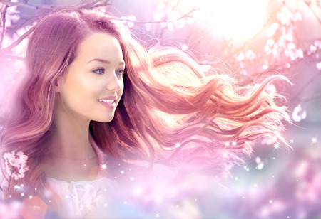 Photo for Beautiful Girl in Fantasy Magical Spring Garden - Royalty Free Image