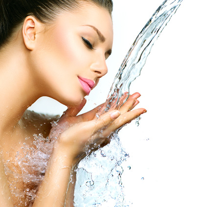Photo for Beautiful smiling girl under splash of water with fresh skin - Royalty Free Image