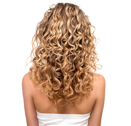 Photo for Beauty girl with blonde permed hair  Backside - Royalty Free Image