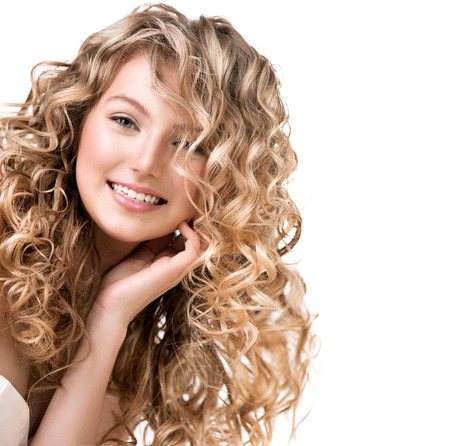 Photo pour Beauty girl with blonde curly hair  Long permed hair - image libre de droit